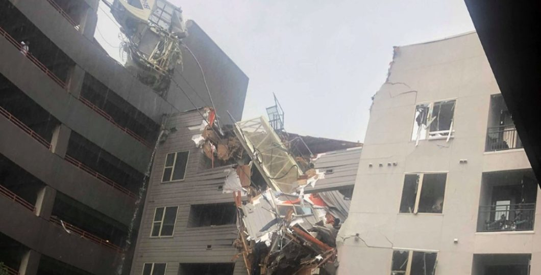 One Died, Six Injured After Crane Collapses On Apartment Building